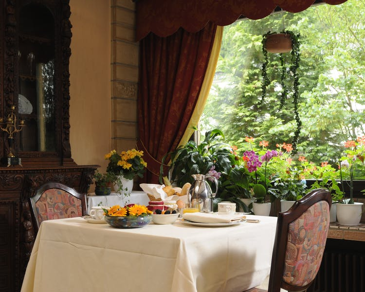 Breakfast table with nature view Hotel-Restaurant Brimer Mullerthal