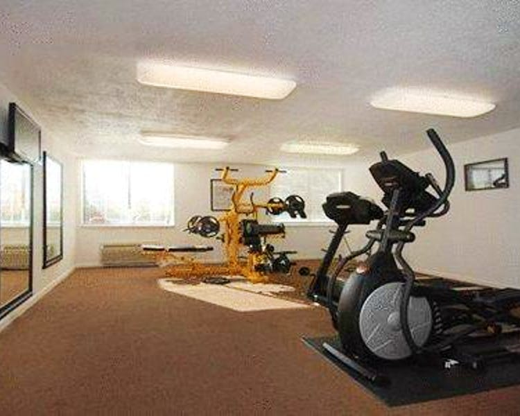 fitness center, including weight station, elliptical, bicycle and treadmills
