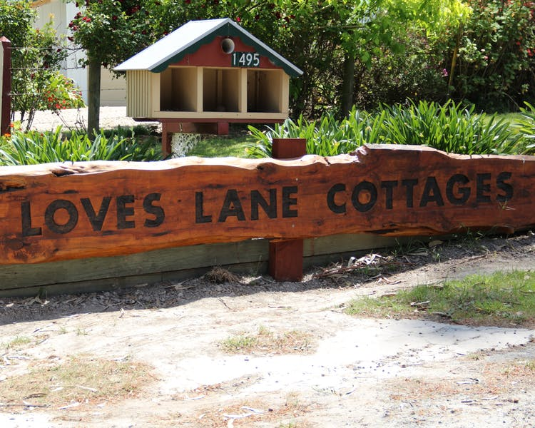 Sign outside Loves Lane Cottages