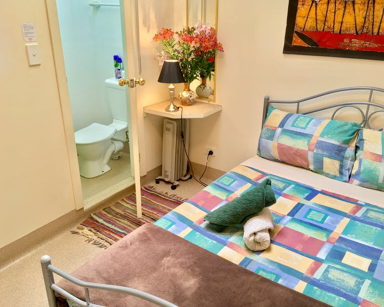 Double en-suite; Compact/small room, with a opening skylight window. Situated at the rear main building. Quiet area.
