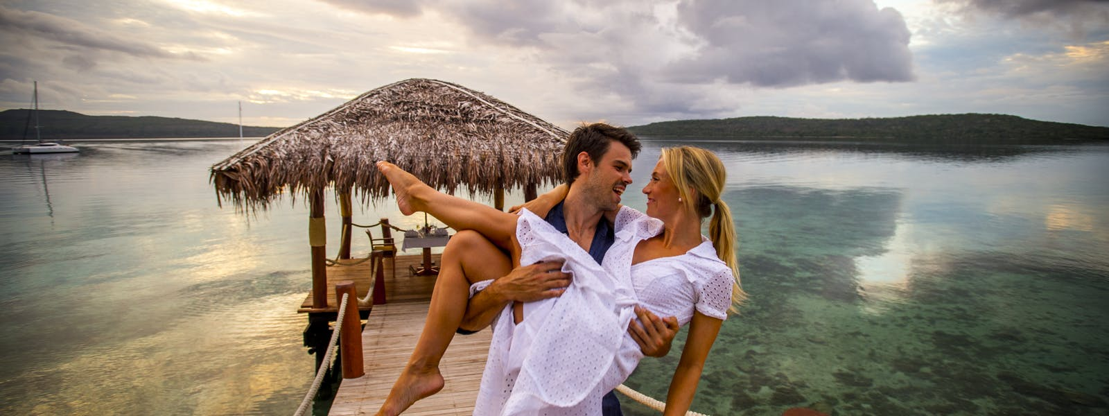 Couple on Jetty The Havannah, Vanuatu. Award winning Luxury resort retreat for couples,  romance, weddings and Honeymoon.