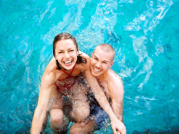 Couple swimming