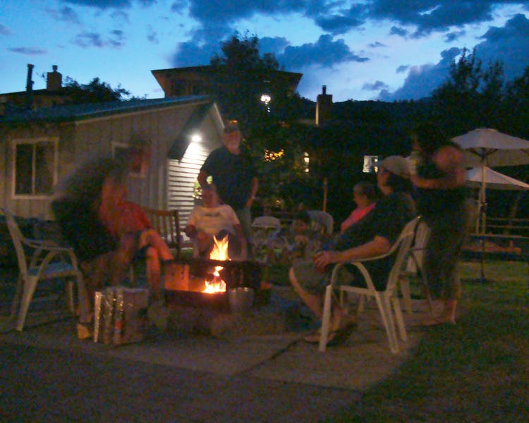 Communal evening campfire offers new friends and roasted marshmallows.