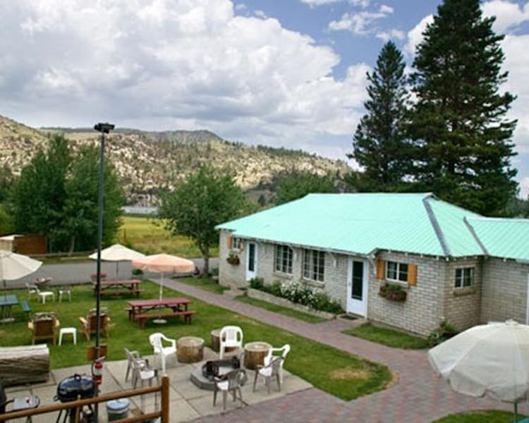 Courtyard view of communal grassed picnic area, campfire pit and entrance to 2-bedroom cabins.