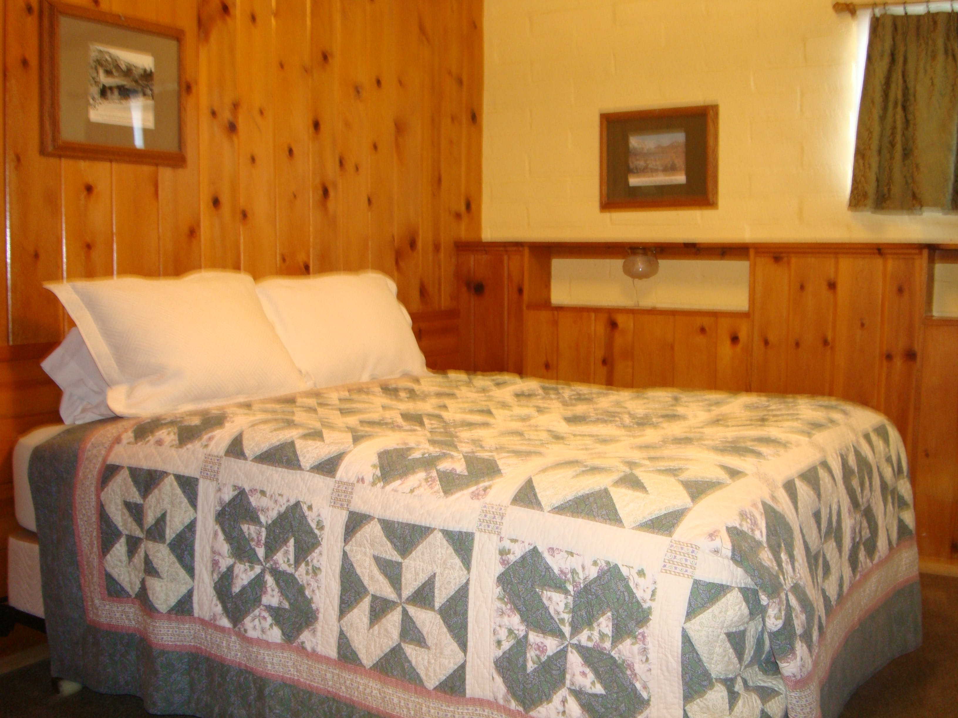 Queen bed in 2-bedroom cabin.