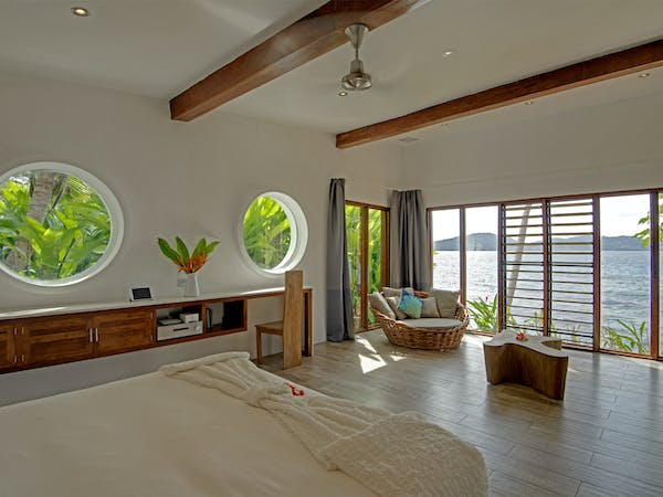 Royal Retreat lounge and bedroom at The Remote Resort Fiji Islands