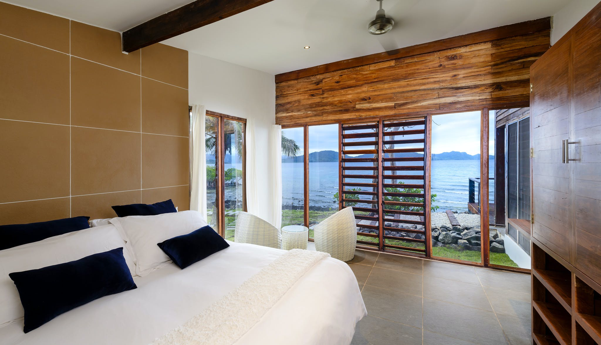King bed in Two-bedroom Villa at The Remote Resort Fiji Islands.  Oceanfront,  plunge pool, family accommodation