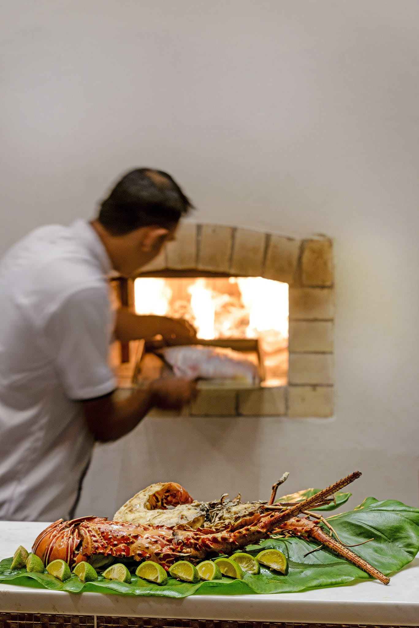 Chef cooking in the wood-fired oven at The Remote Resort Fiji Islands