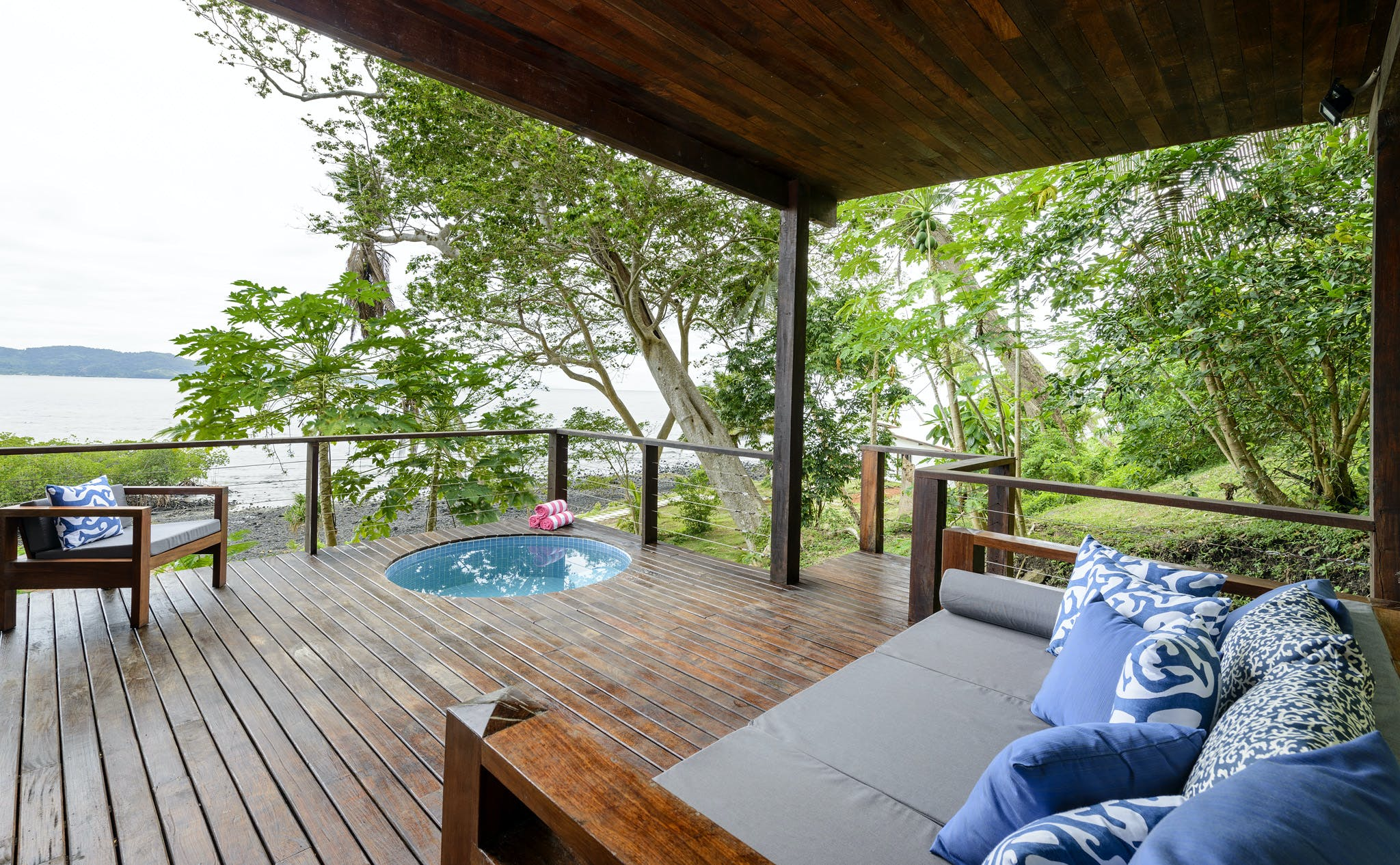 Deck, plunge pool and outdoor lounge in an Oceanfront Villa at The Remote Resort Fiji Islands.