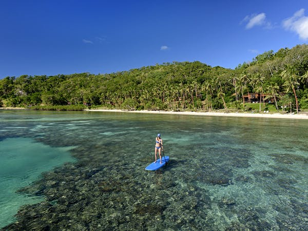 SUP on the house reef at The Remote Resort Fiji Islands