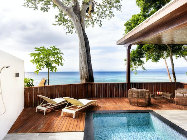 The deck of an Oceanfront Retreat at The Remote Resort Fiji Islands with large plunge pool and sun loungers