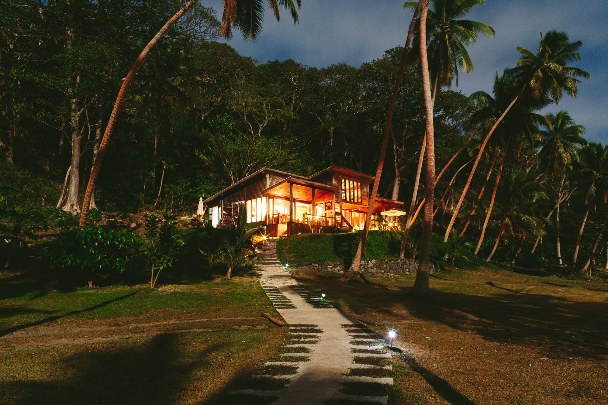 The Main Pavilion at night from the path at The Remote Resort Fiji Islands