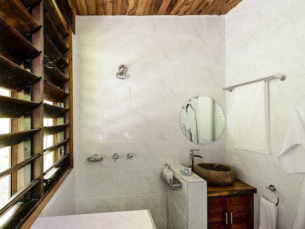 Ensuite bathrooms in Two-bedroom Villa at The Remote Resort Fiji Islands.  Oceanfront,  plunge pool, family accommodation