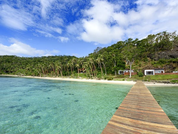 View of the Oceanfront Retreats and main beach from the jetty at The Remote Resort Fiji Islands