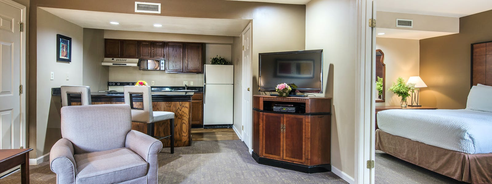 Cloverleaf Suites Living Room with Bedroom Shown