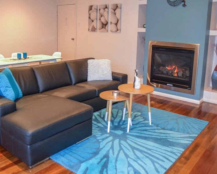 Relax on the lounge with cosy gas log fire at Blue Ridge Retreat