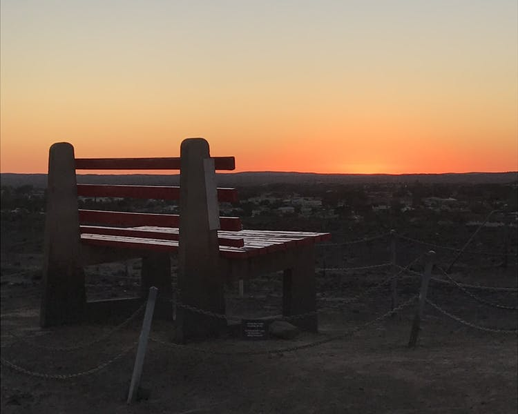 Big red chair. Line of Lode. Sunset view Broken Hill