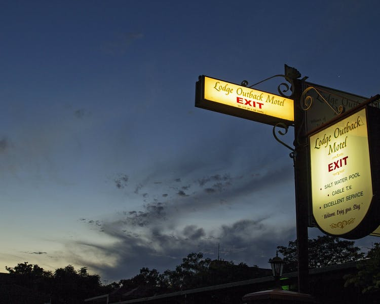 Lodge Outback Motel at night exit sign sunset