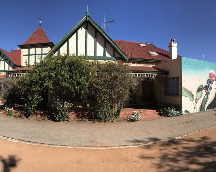 Street view with mural Lodge Outback Motel Broken Hill