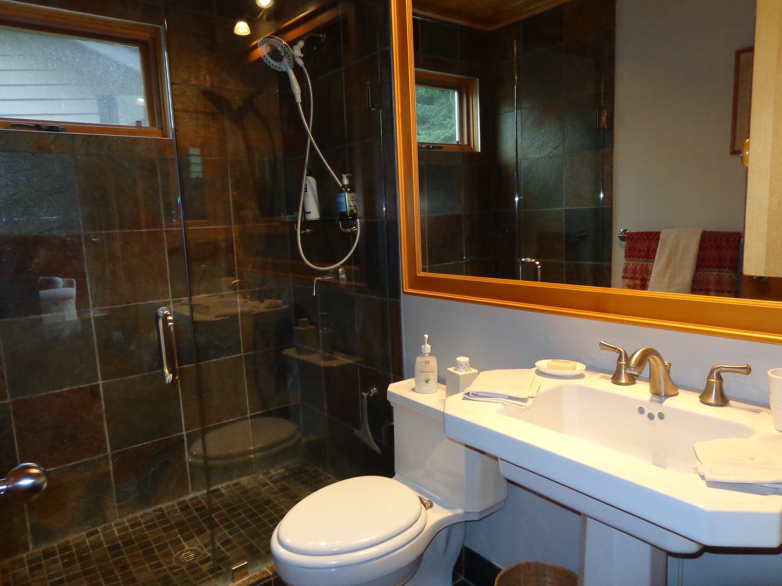 Garden View suite has stylish private bathroom with full shower