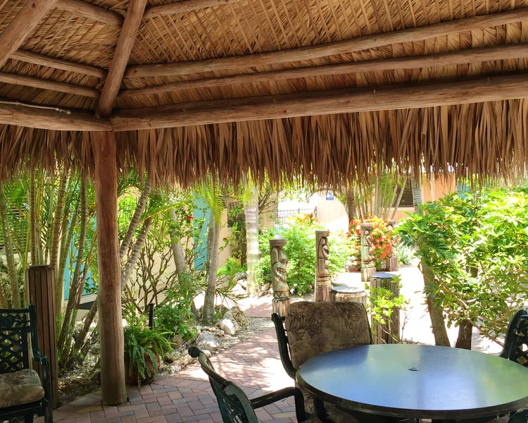 Enjoy the breeze under our tiki huts!