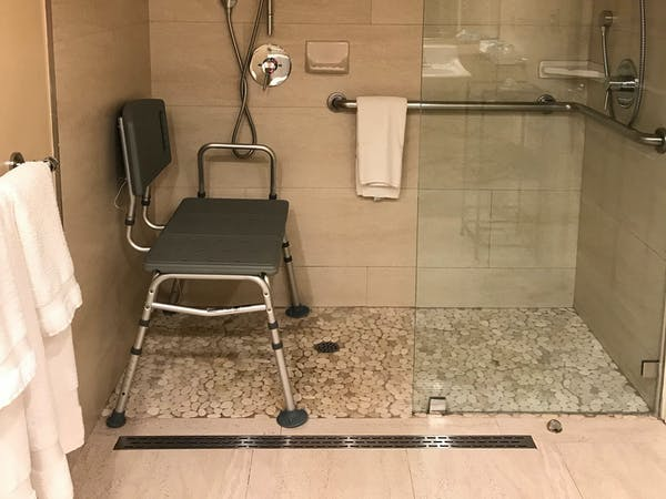 ADA wheelchair accessible bathroom, shower with bench