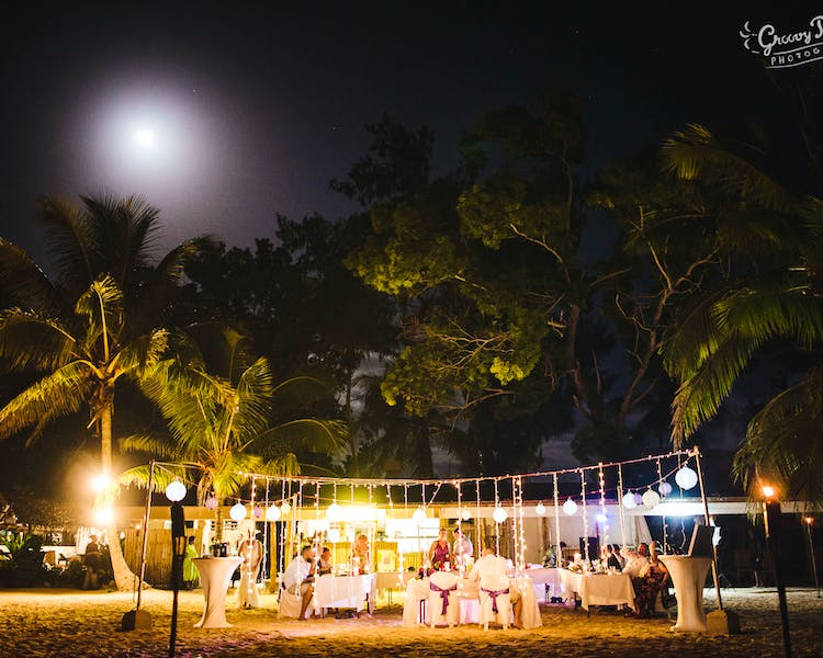 Beach wedding reception with fairylights