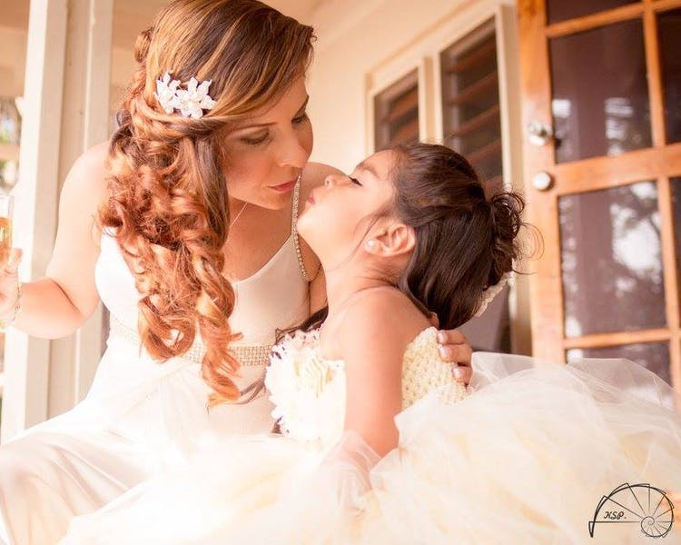 Bride & flower girl enjoying a special moment on the deck of their villa