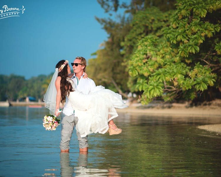 Bride and groom in Erakor Lagoon