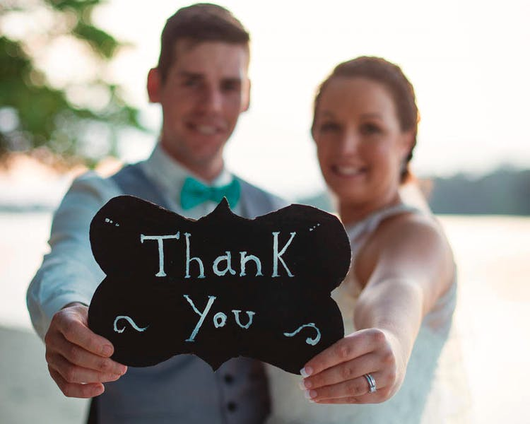 Say thank you to all your family & friends who joined you on Erakor Island for your tropical wedding celebration