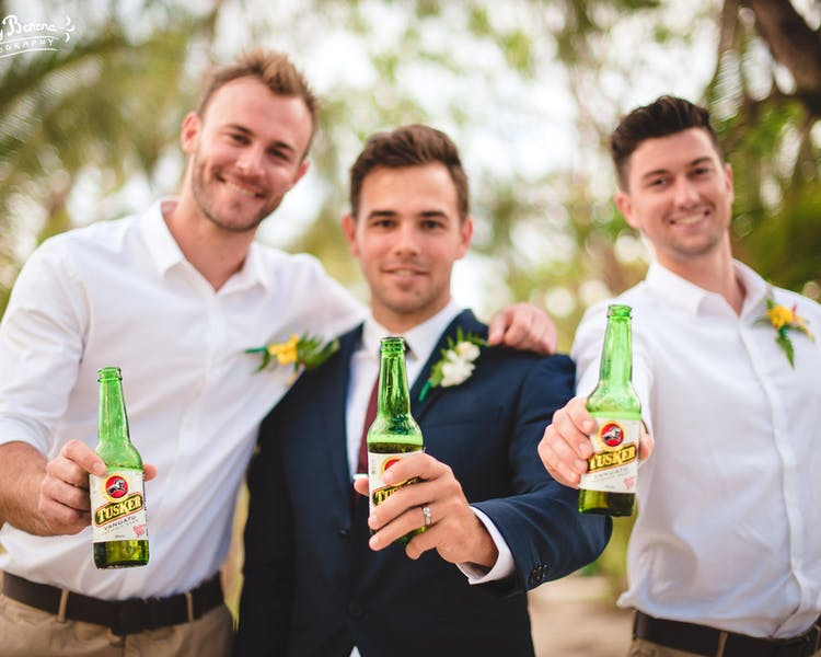 Groom & Groomsman with Tusker beer.