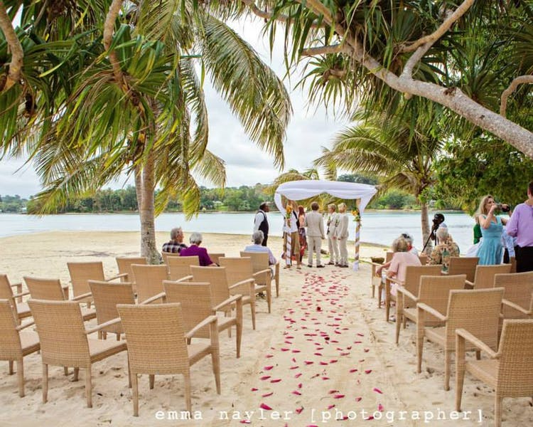 Coconut Beach Wedding Ceremony with Rattan Chairs