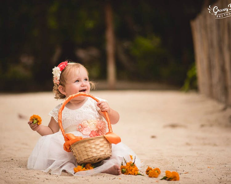 Flowergirl with petal basket on Calypso Beach