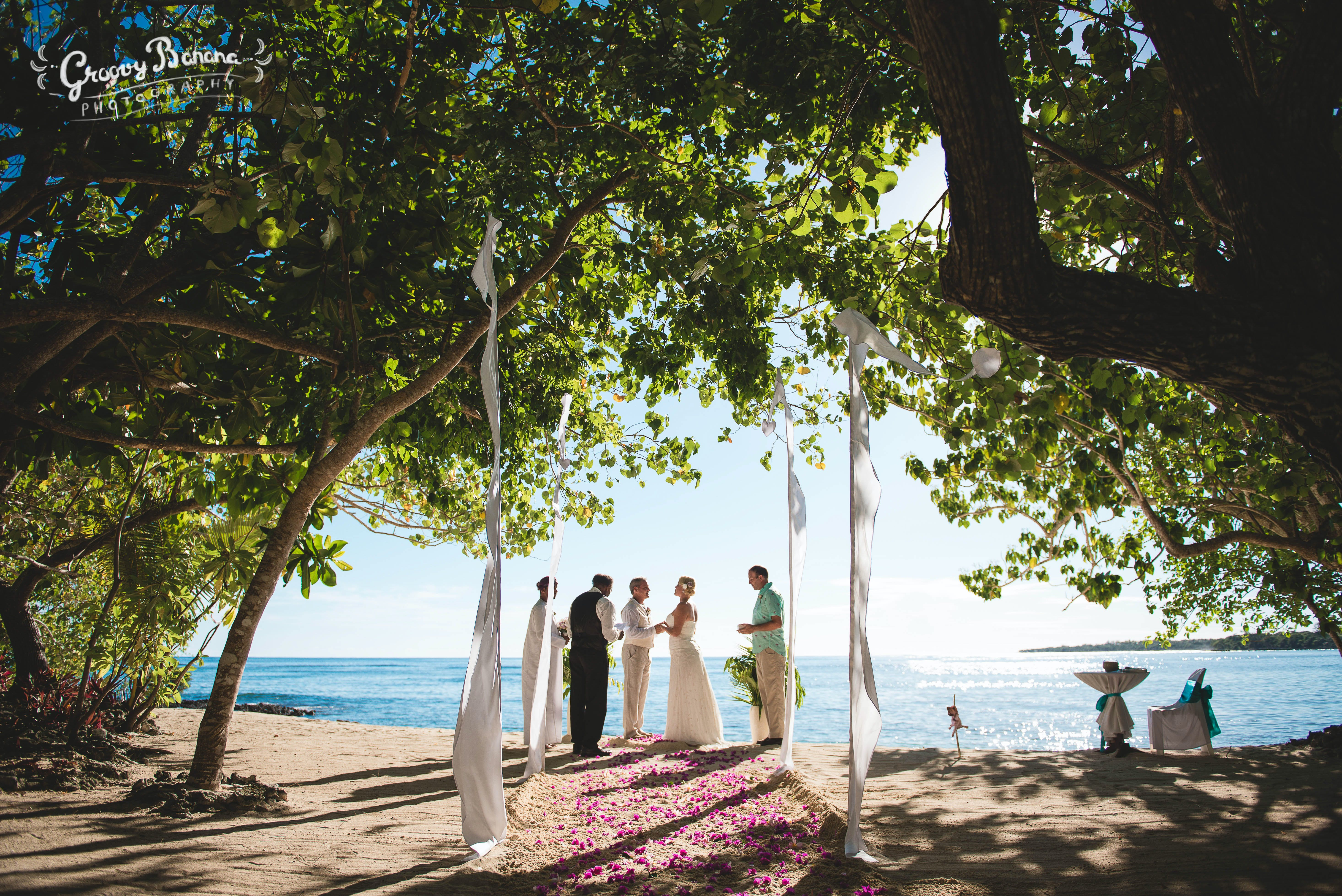 Sunset Beach, scattered floral aisle and Bali Flags