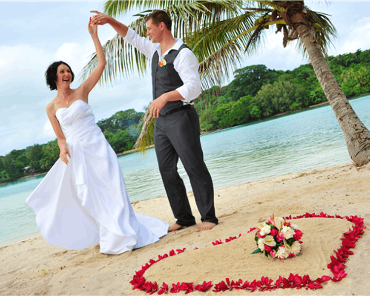 Ceremony on Coconut Beach with floral heart in the sand