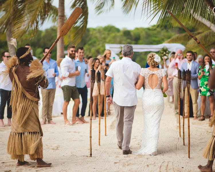 Wedding aisle lined with tiki torches