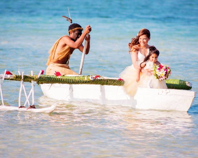 Bride & Flowergirl on the Outrigger Canoe