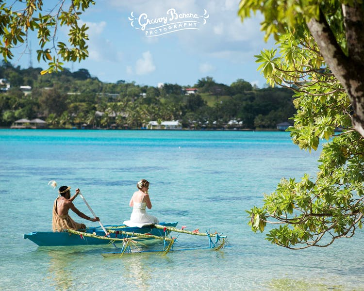 Arrive to your wedding on a traditional Outrigger Canoe