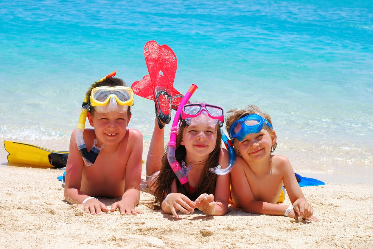 kids snorkelling on the beach
