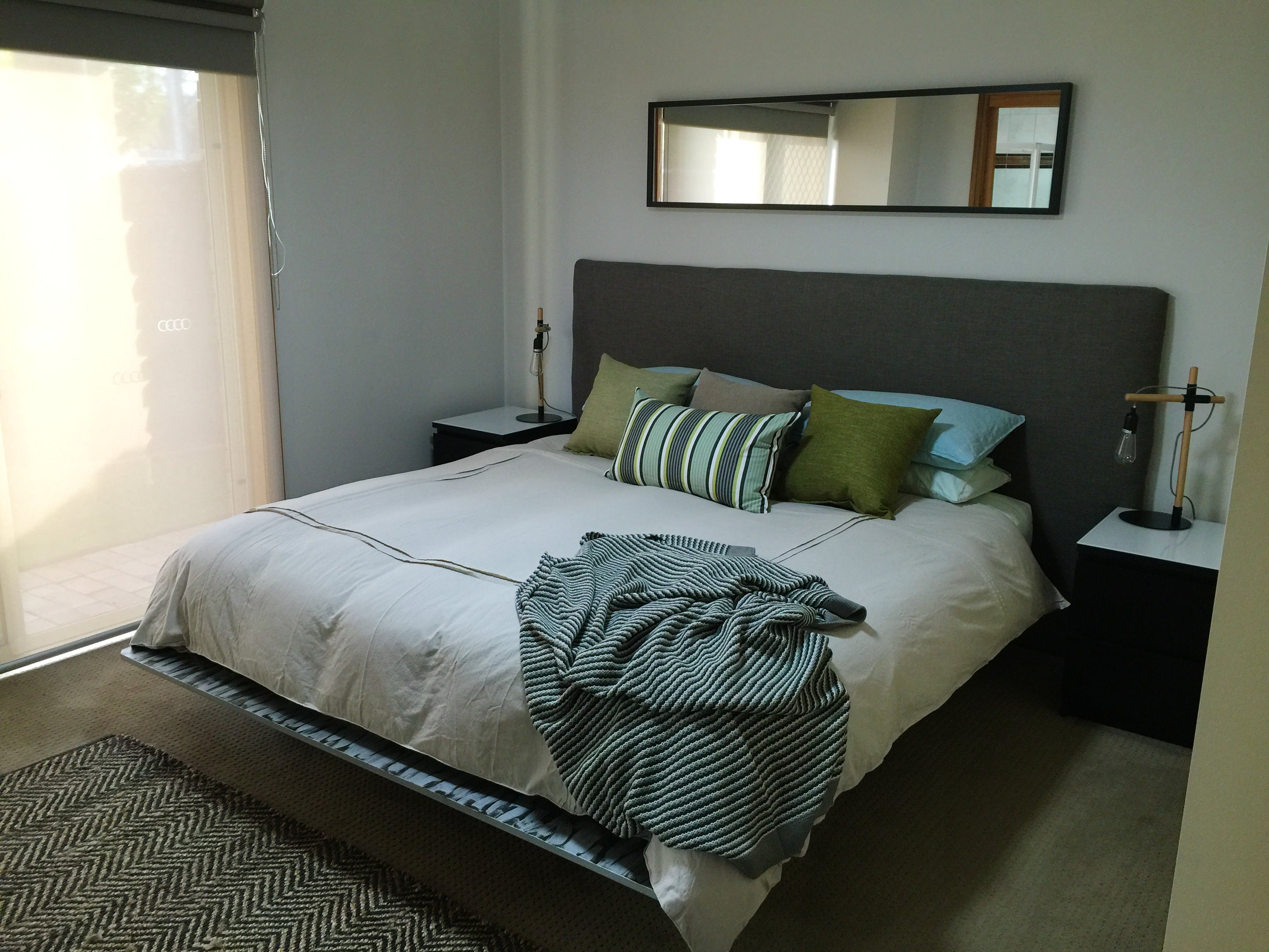 Downstairs king bedroom with ensuite and access to lawned courtyard