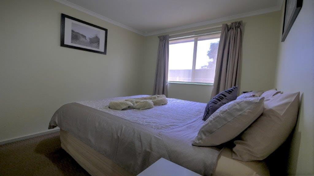 Comfortable bedding with quality linen in Superior Apartment all beds have electric blankets