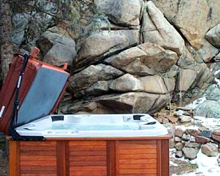 Outdoor Hot Tub at the Lodge up against the rocks