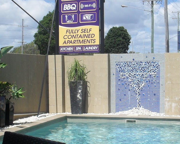 Outdoor pool at Charm City Motel Bundaberg
