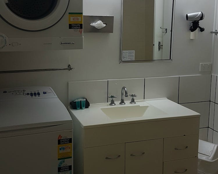 Family room bathroom with a washing machine and dryer