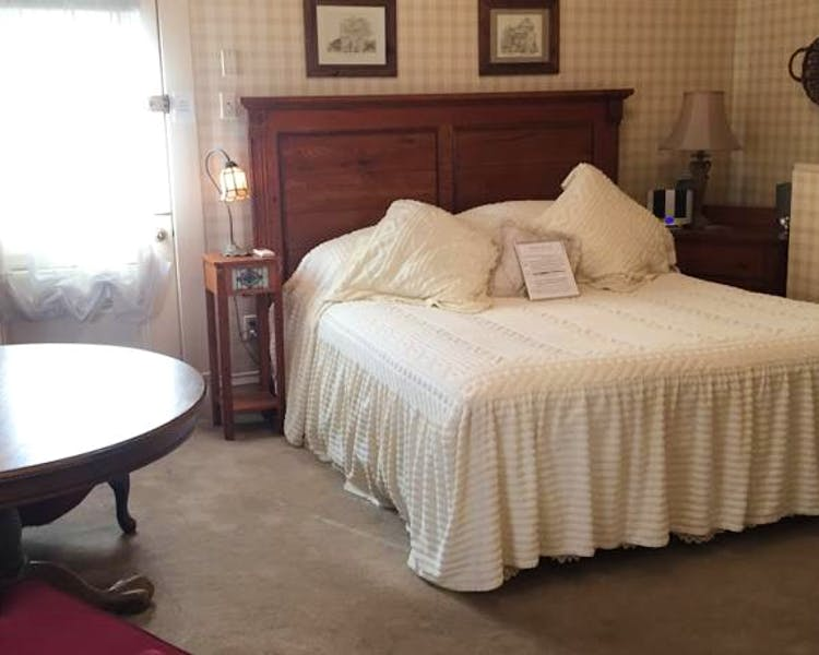 Private entrance and king bed in Yosemite Suite