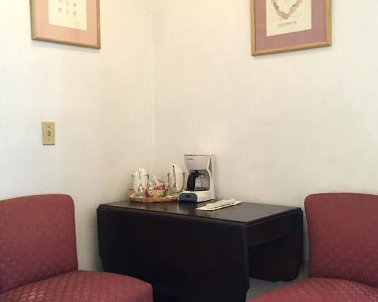 Table, chairs and coffee maker in Prospector Room