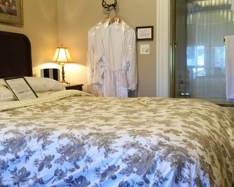 Robes and queen bed in Tuolumne Room