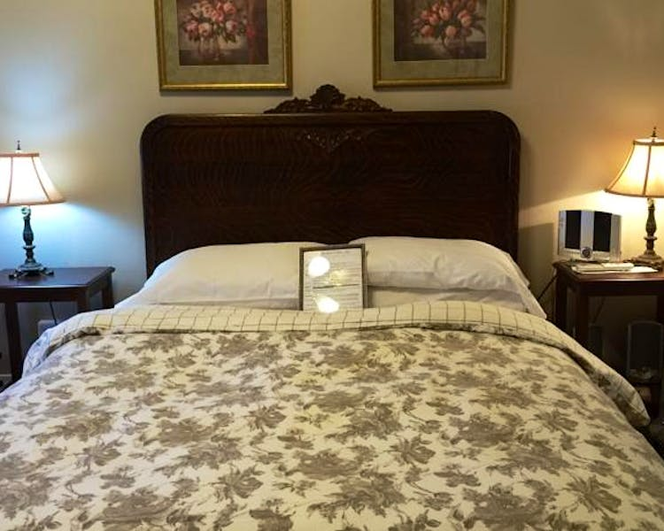 Tiger-oak headboard of  bed in Tuolumne Room
