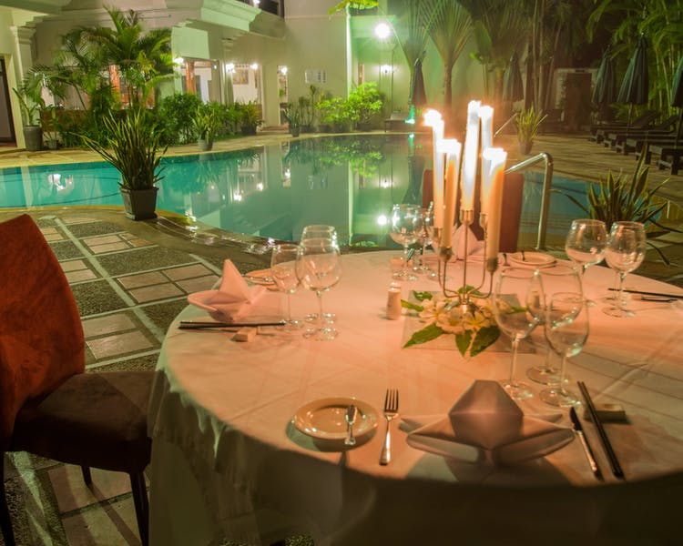 Romantic dinner by poolside