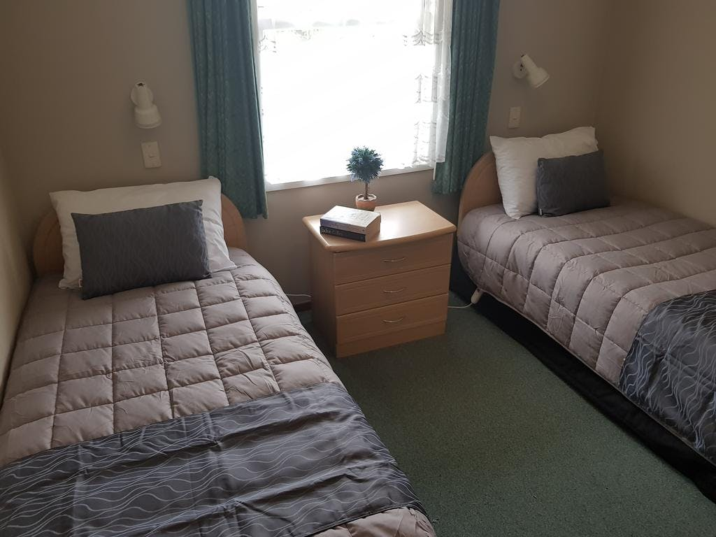 Single beds in a two bedroom cottage